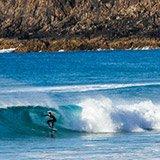 Commentaire de Thibault sur son séjour surf à Fuerteventura, Corralejo, avec Sophie et Trip Adékua
